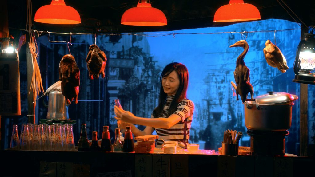 A woman serving drink in a restaurant